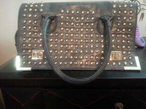 Leather grey bag with medal accents