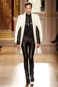 black leather pants with black leather top and white cape jacket. Gorgeous! mixed media top and black and white trend